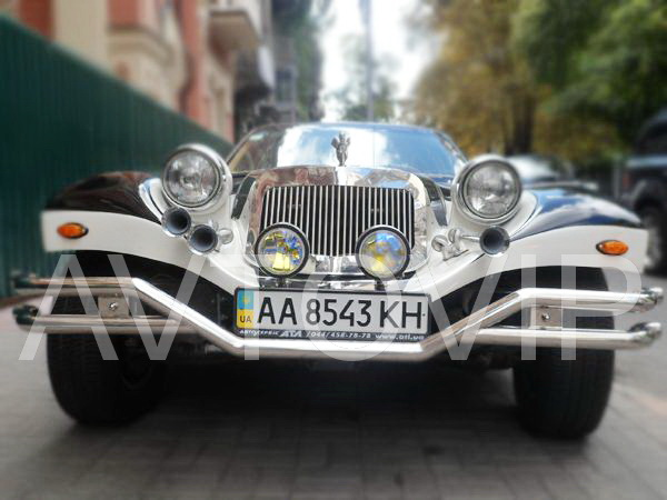 Exalibur черно белый седан ретро авто